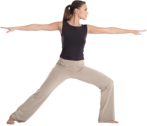 Woman in khaki pants and a tank top holding the warrior pose at Forward Motion Yoga
