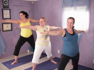 Three pregnant women doing yoga at Forward Motion Yoga