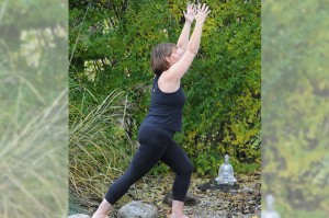 Marg Drudge doing yoga in a green garden