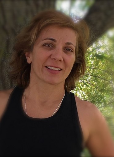 A photo of Louise Lee, a trainer for Forward Motion Yoga.