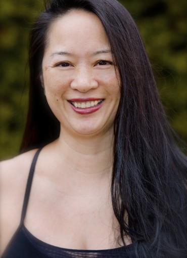 A photo of Lorraine Li, a trainer at Forward Motion Yoga.