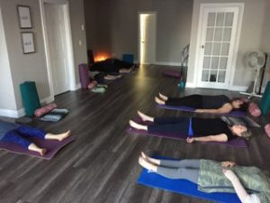 Photo of the interior of the Forward Motion Yoga studio during a class.