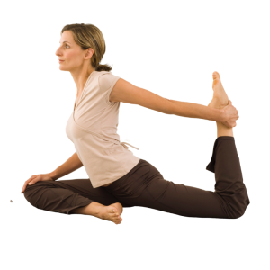 A woman in a white top and black pants holding her foot in a yoga pose.