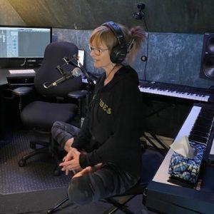 "A photo of Cheryl Ward, recording the Forward Motion Yoga program ""3 Minutes to Calm."""