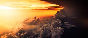 Grey clouds in an orange sky.