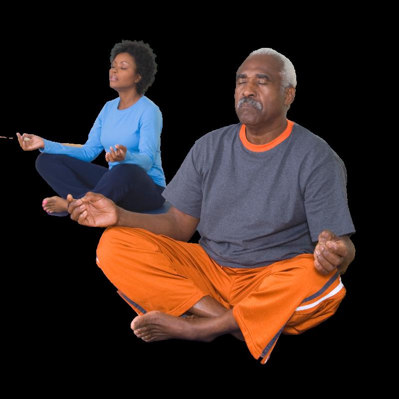 A couple sitting cross legged doing yoga.