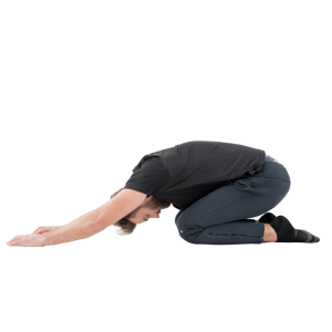 Man in all black doing child's pose.