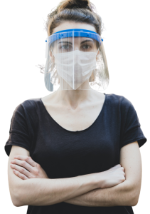Woman standing with her arms crossed wearing a face shield and mask.