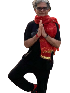 A photo of Deepak Chopra doing a yoga pose while wearing a red scarf.