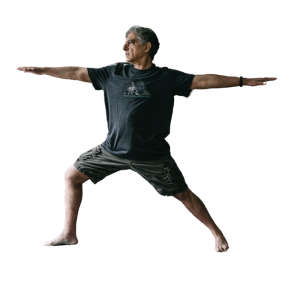 Man doing a yoga pose with his arms extended and his legs in a lunge position.