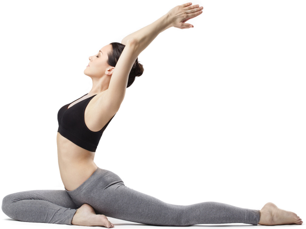 Woman in black top and grey leggings doing yoga.